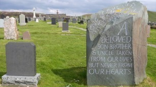 Grave of fashion designer Alexander MCQueen on the island of  Skye